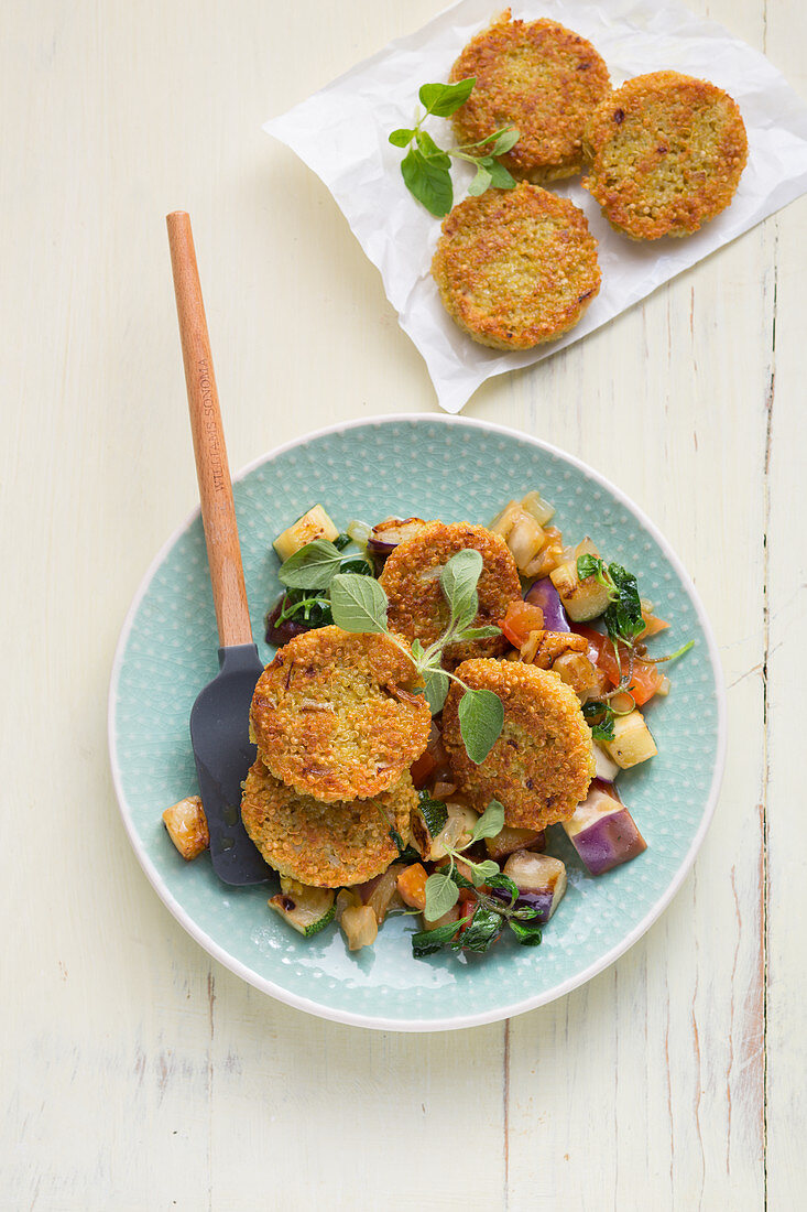Vegan quinoa fritters with vegetable ragout