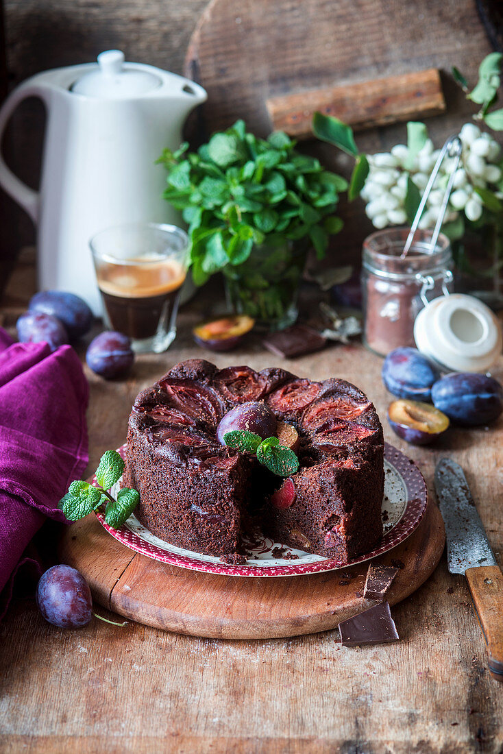 Chocolate cake with plums, sliced