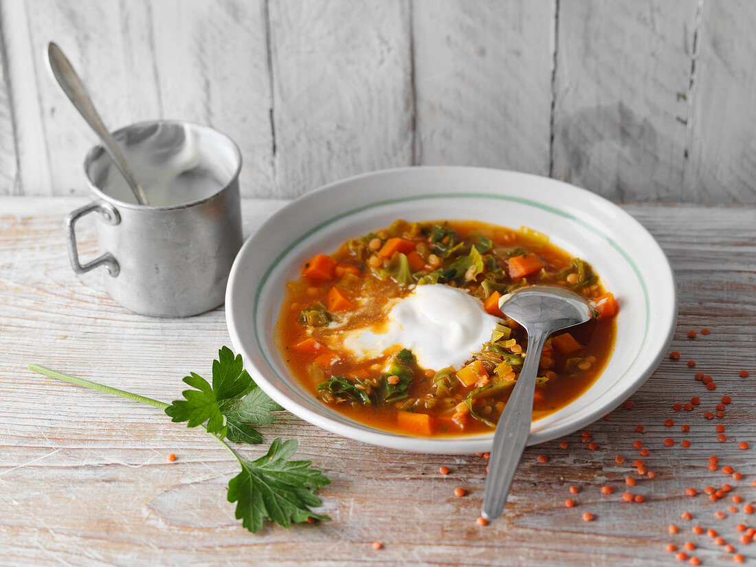 Red lentil soup with savoy cabbage and sour cream