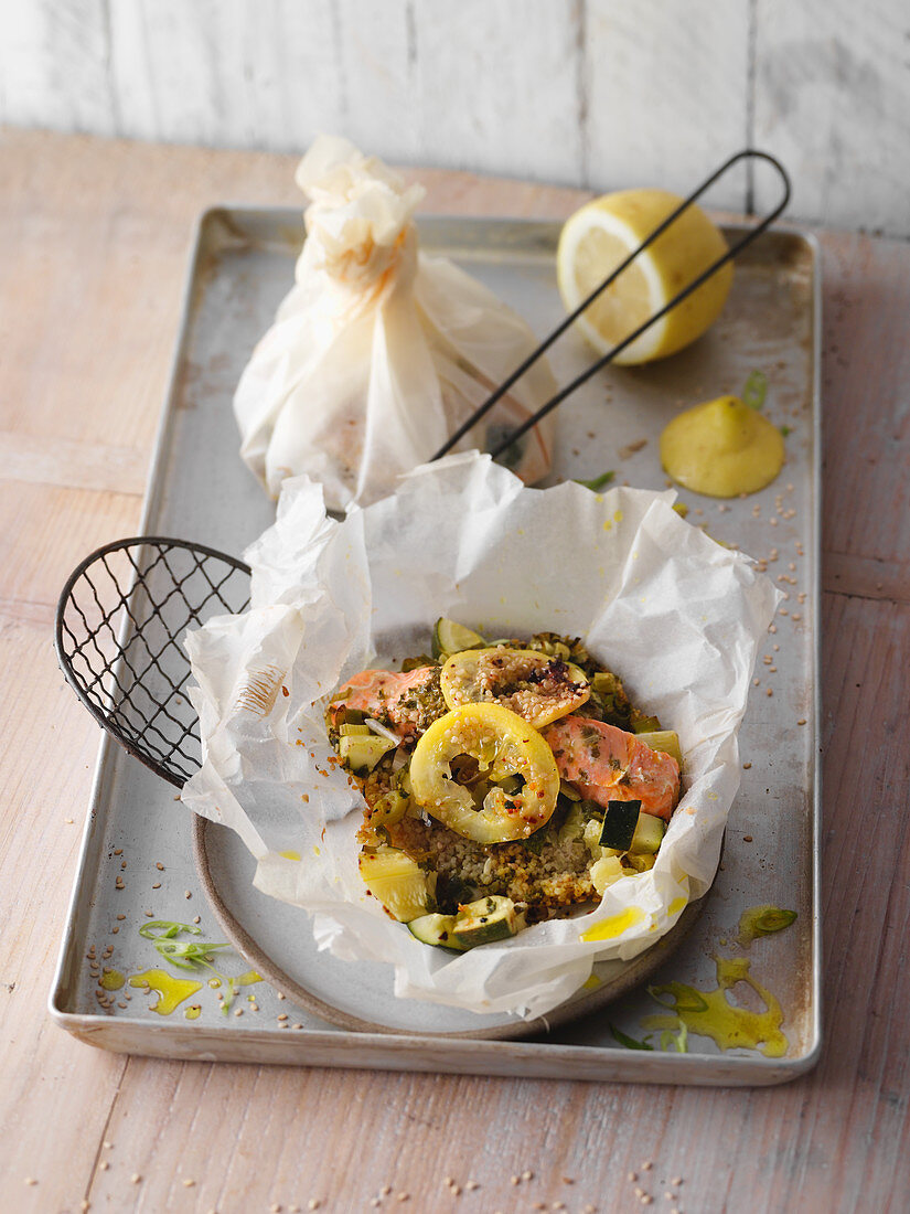Oven-baked salmon and courgette parcels with lemon and couscous