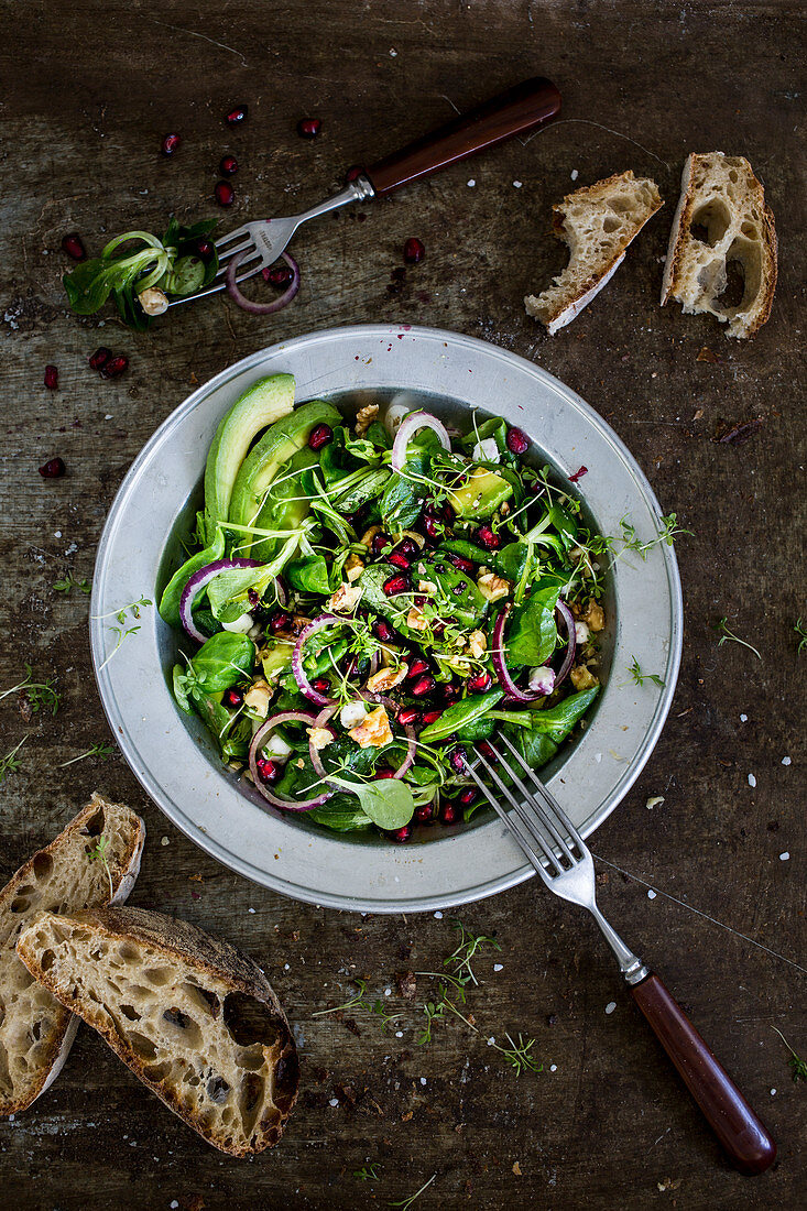 Mixed leaf salad with avocado and pomegranate seeds