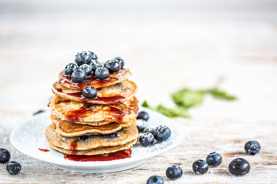 Blueberry pancakes with blueberries and maple syrup