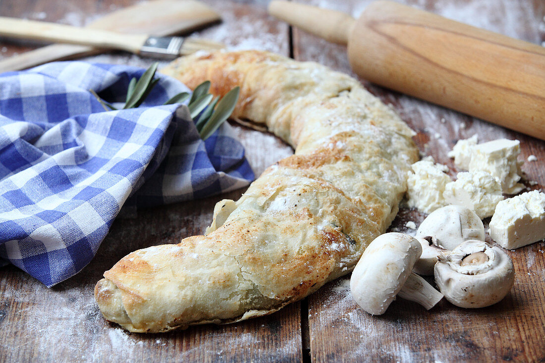Spinach and mushroom strudel with feta cheese