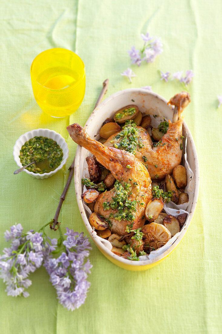 Chicken legs with potatoes, garlic and salsa verde