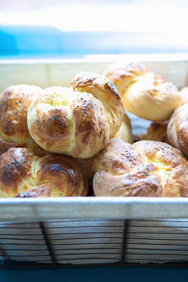 Poppy seed bread rolls in a bread basket