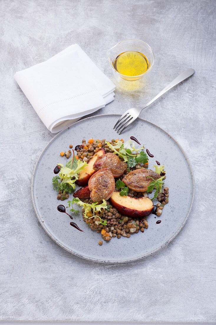 Quail breast on lentils with peaches