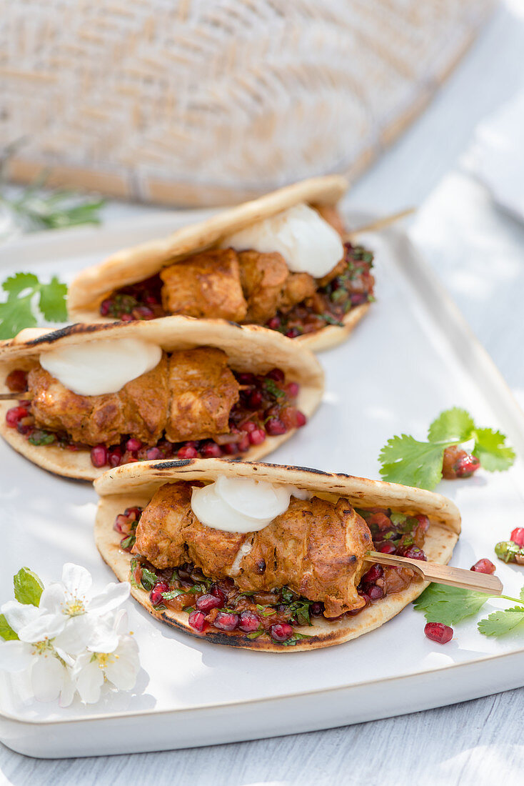 Summer chicken skewers with pomegranate salsa in unleavened bread (Morocco)