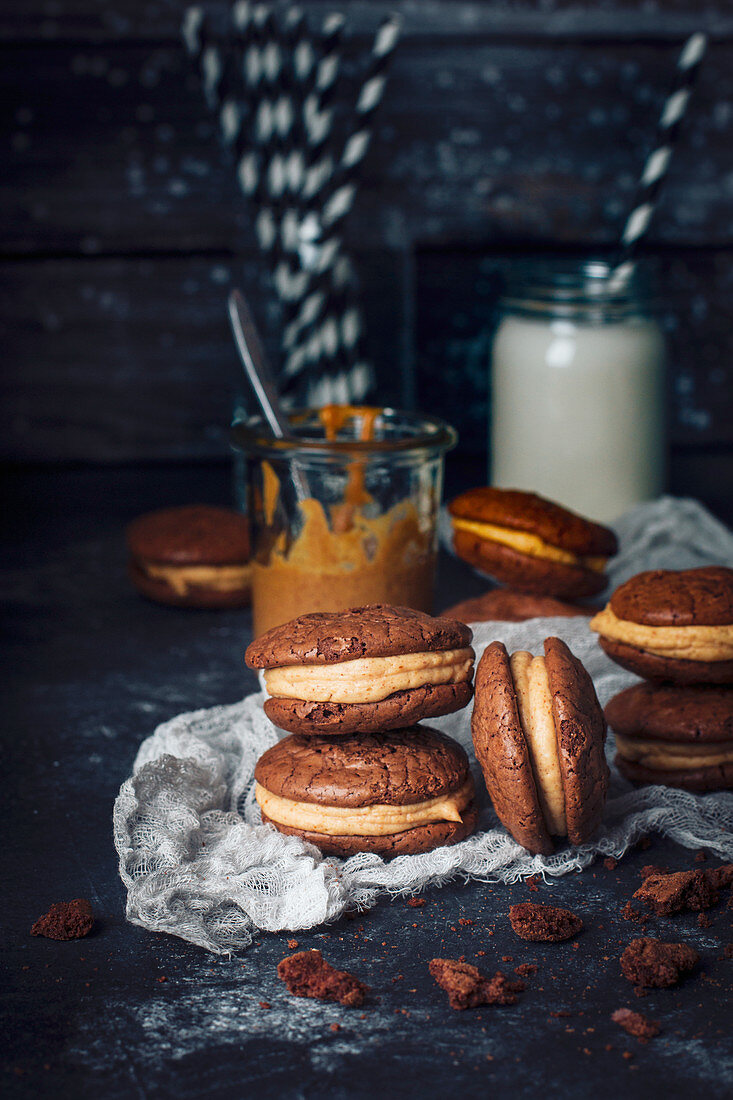 Chocolate brownie cookies with peanut butter filling, with milk