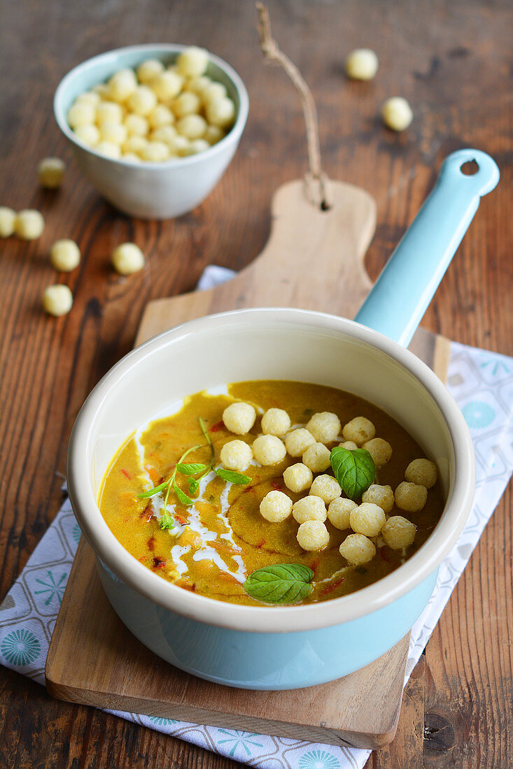 Curry soup with millet balls in an enamel pan