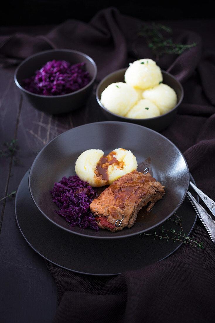 Stuffed vegan soya steak with dumplings, red cabbage and wild mushrooms sauce