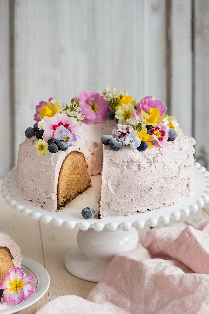 A festive Easter cake with blueberries cream