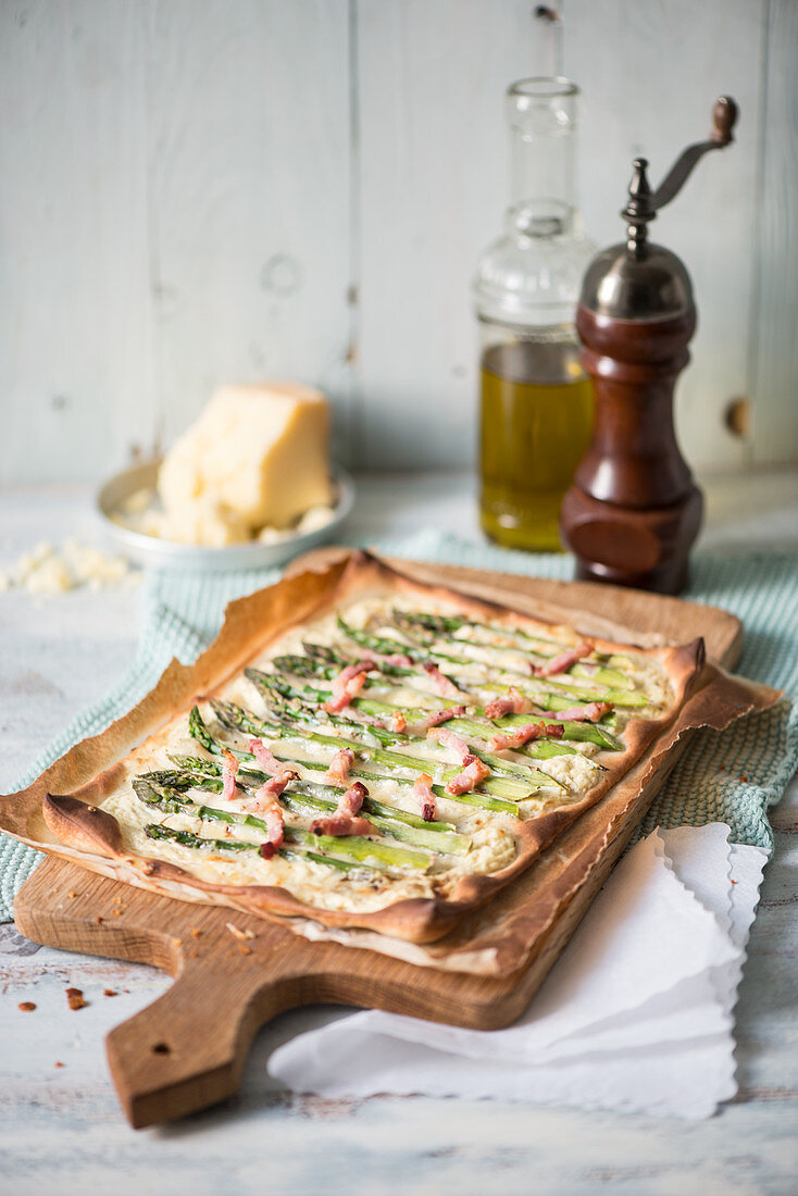 Tart flambeé with green asparagus and bacon strips