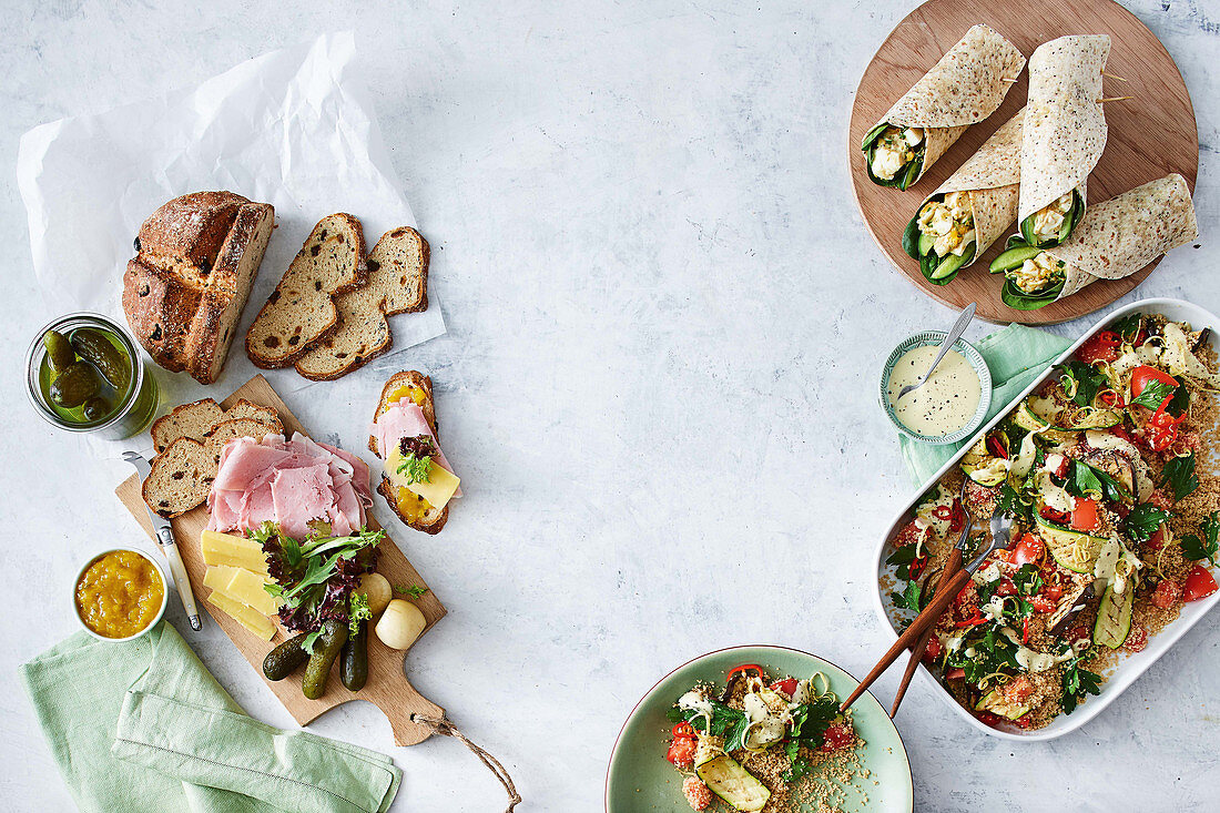 Ploughman s lunch with seed soda bread, Dukkah-spiced egg wraps, Grilled vegetable salad with tahini dressing
