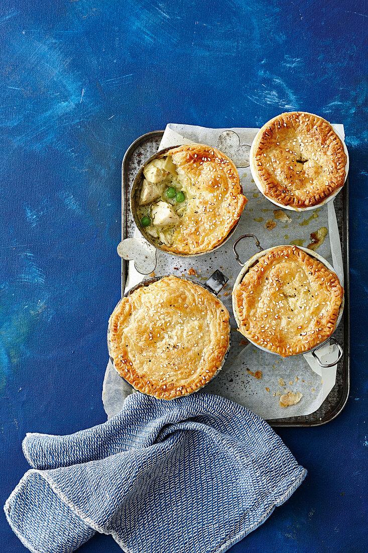 Creamy chicken artichoke and pesto pot pies