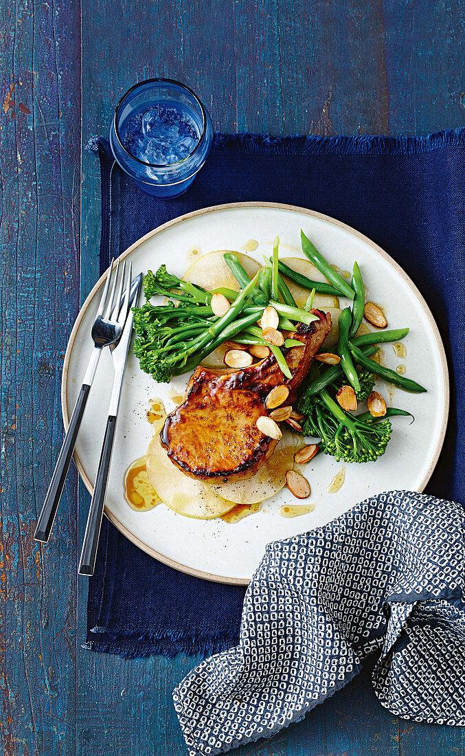 Sticky hoisin pork chops with broccolini and nashi salad