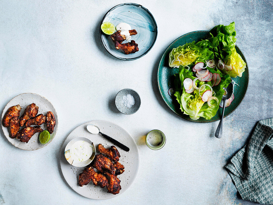 Coal-fired Jamaican chicken wings with radish and butter lettuce salad