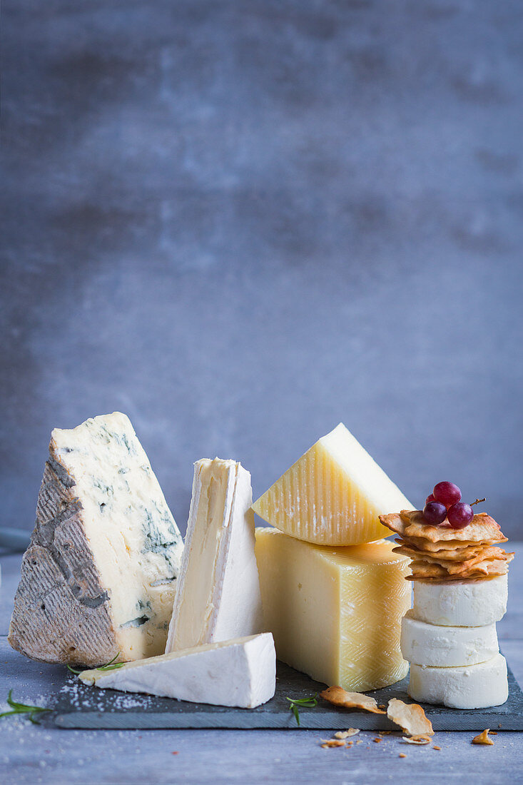 Various cheeses on a slate board
