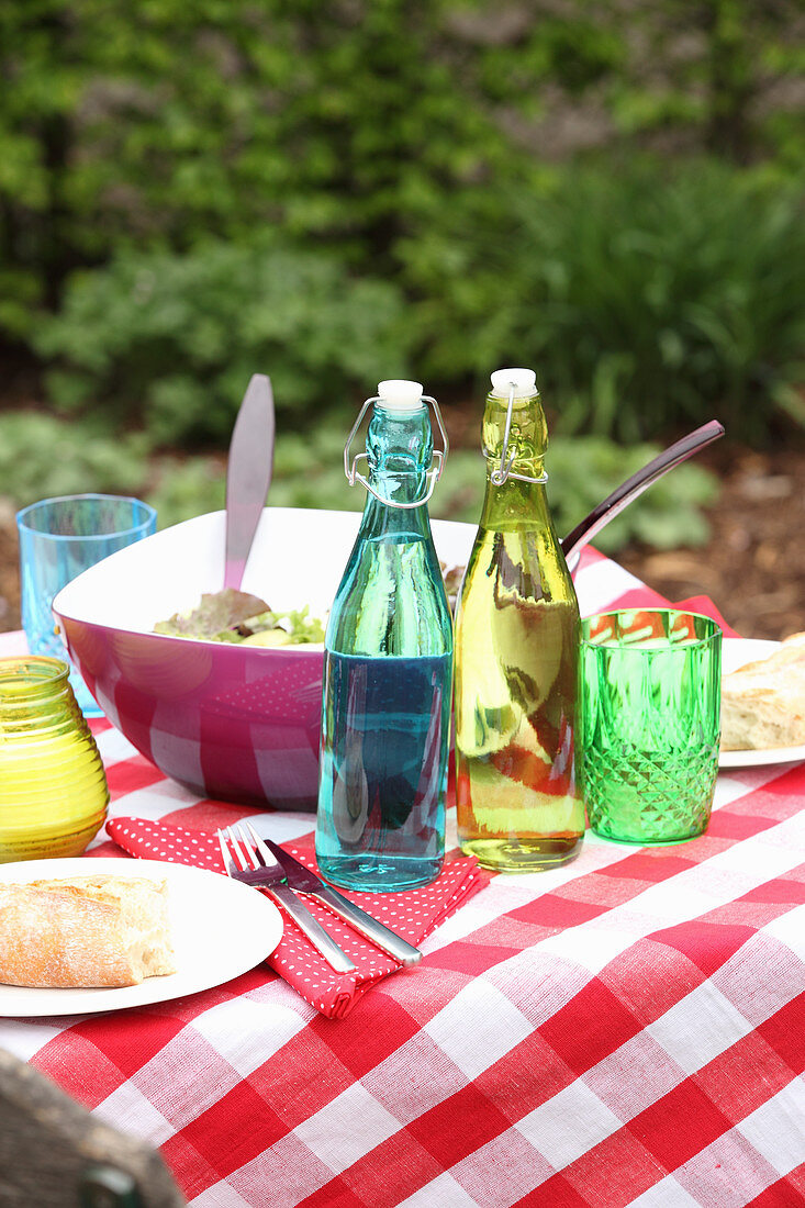 Bread, salad and drinks for a barbecue party