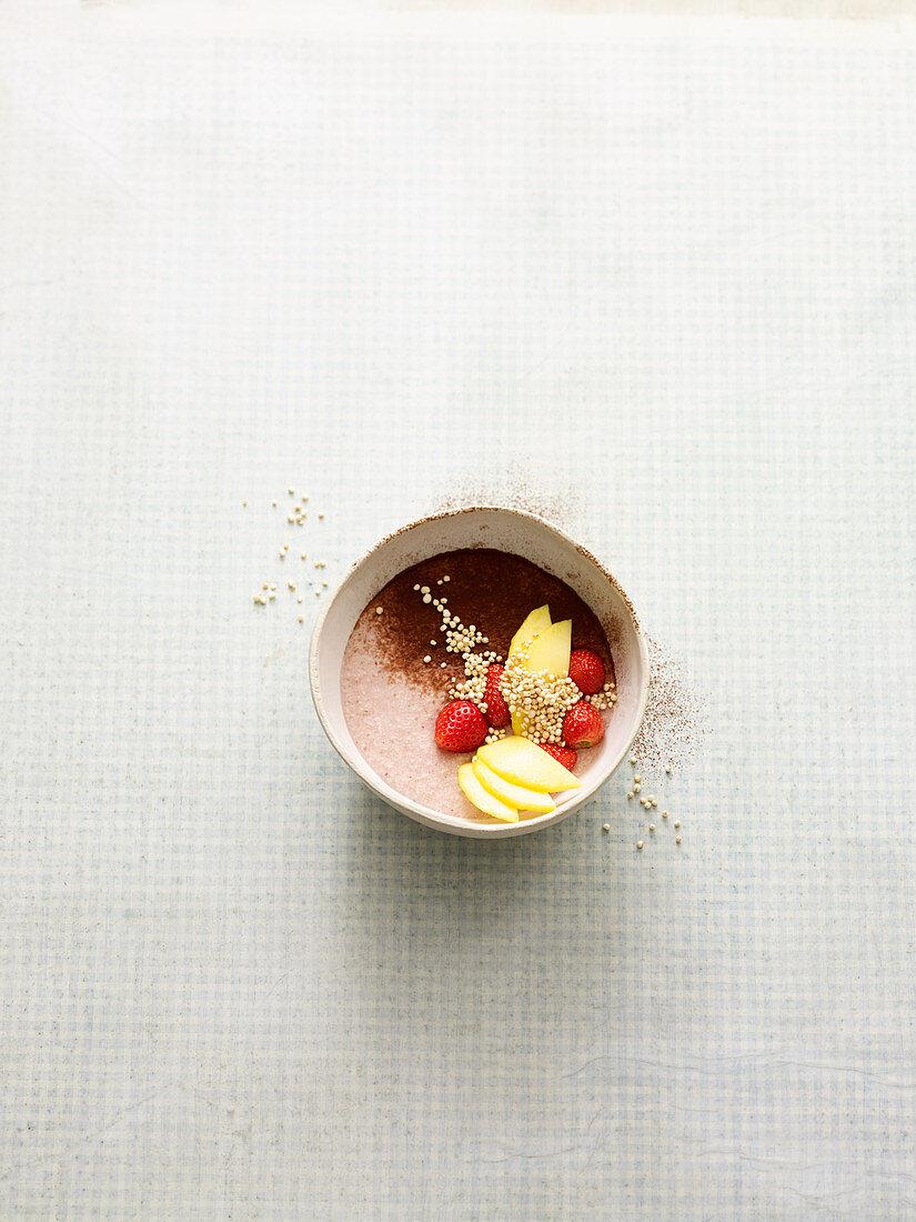 Vegan quinoa bowl with strawberries and mango