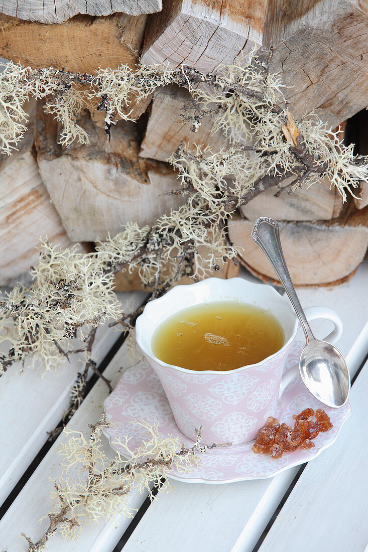 A cup of Sencha tea with sugar crystals