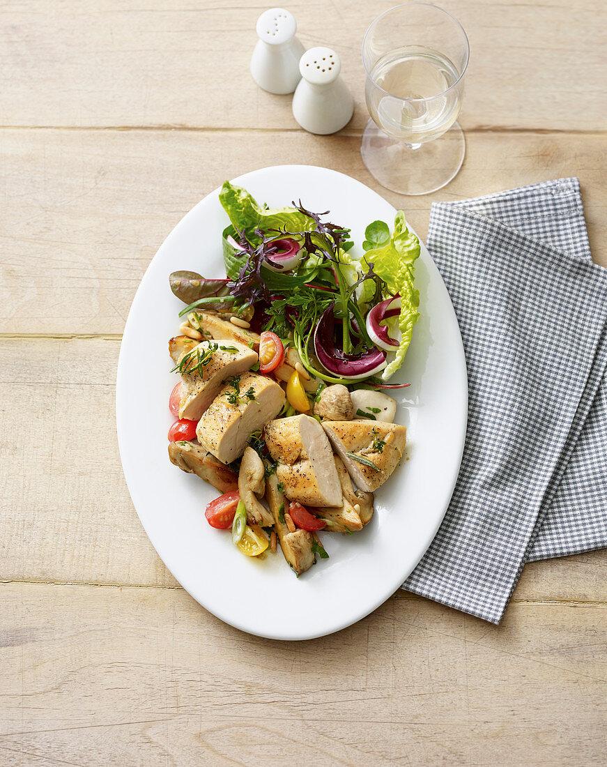 Roasted corn-fed chicken on a mushroom salad