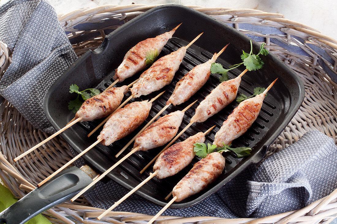 Mini chicken kebabs on grill pan