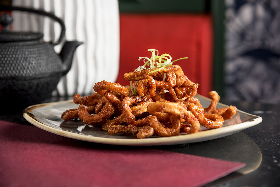 Filipino style deep fried crispy squid glazed with chilli honey and garlic