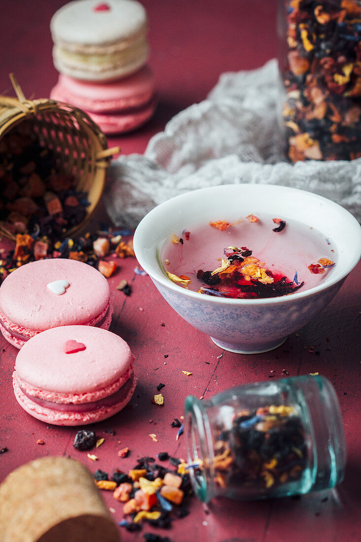 Berry macarons wih hearts and red tea