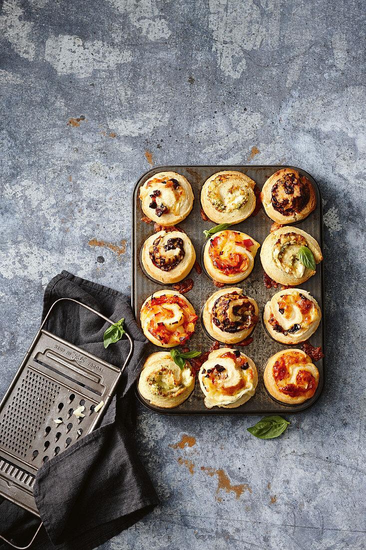 Scrolls with ham, cheese, pineapple scrolls; Sun-dried tomato, olive and cheese scrolls; Cheesy vegemite scrolls; Pesto and fetta scrolls