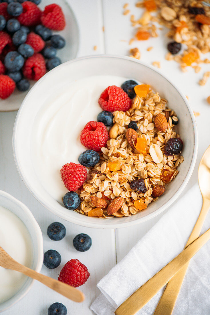 Homemade granola with fresh berries and Greek yoghurt