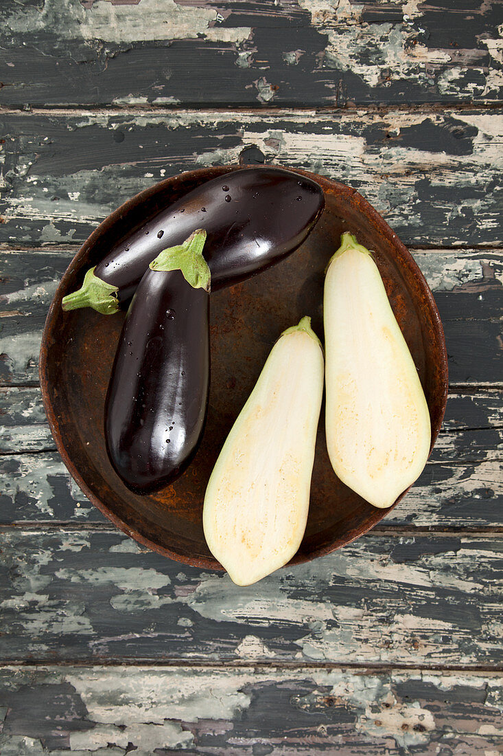 Aubergines, whole and halved