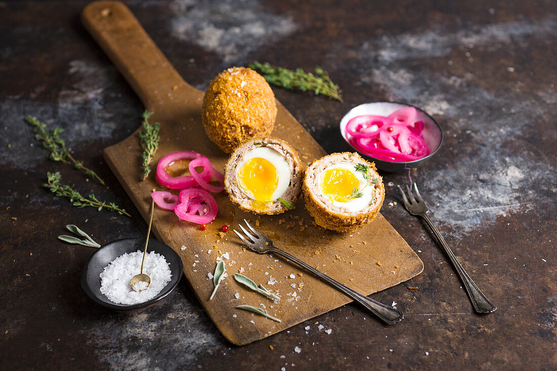 Scotch eggs with pickled onions