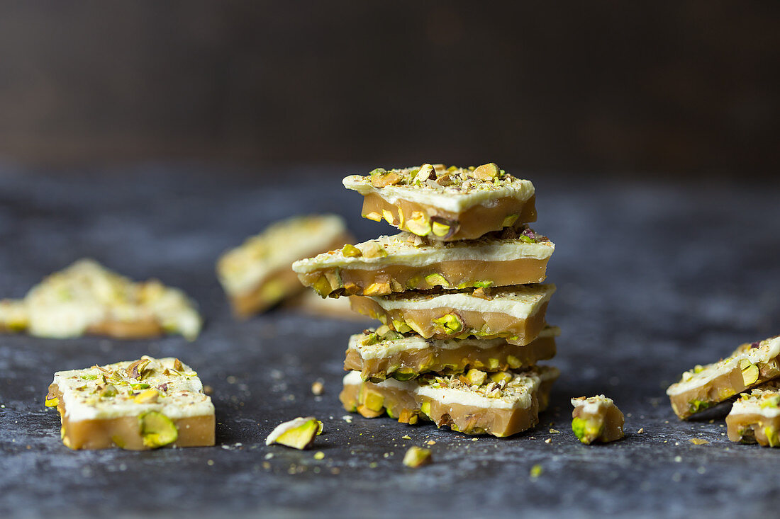Caramel with white chocolate and pistachio nuts