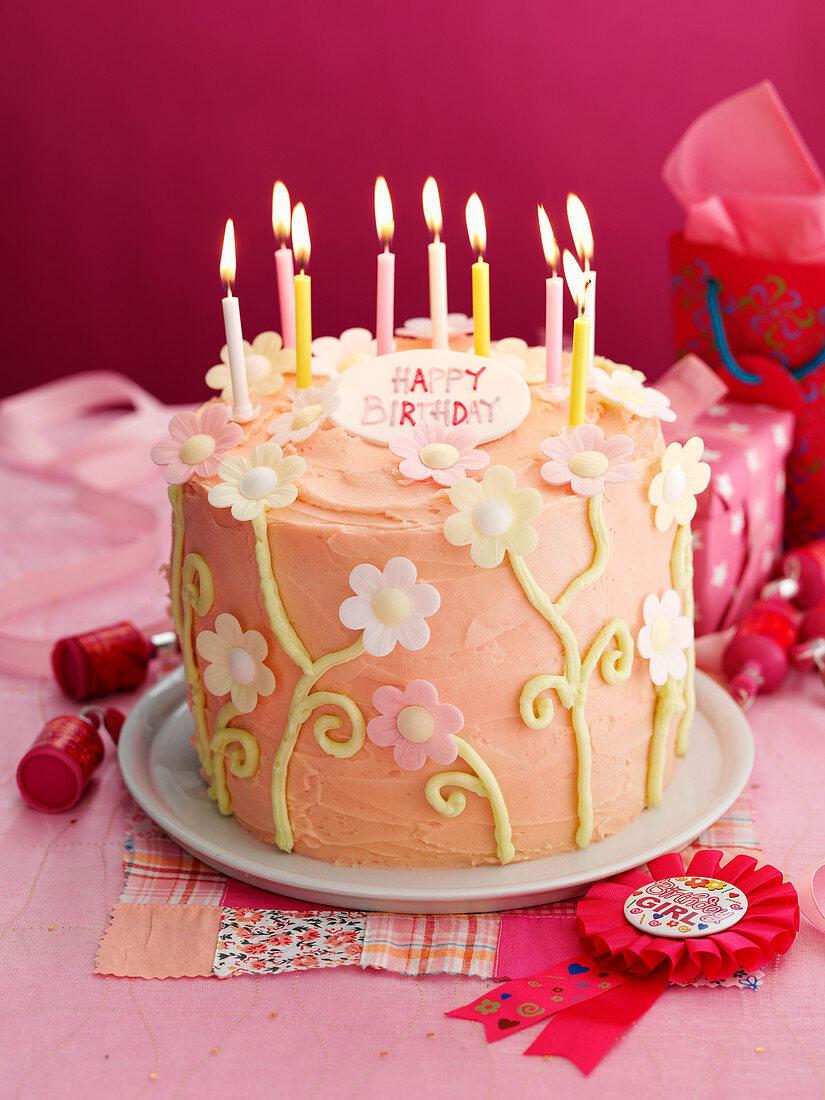 Pink birthday cake with sugar flowers