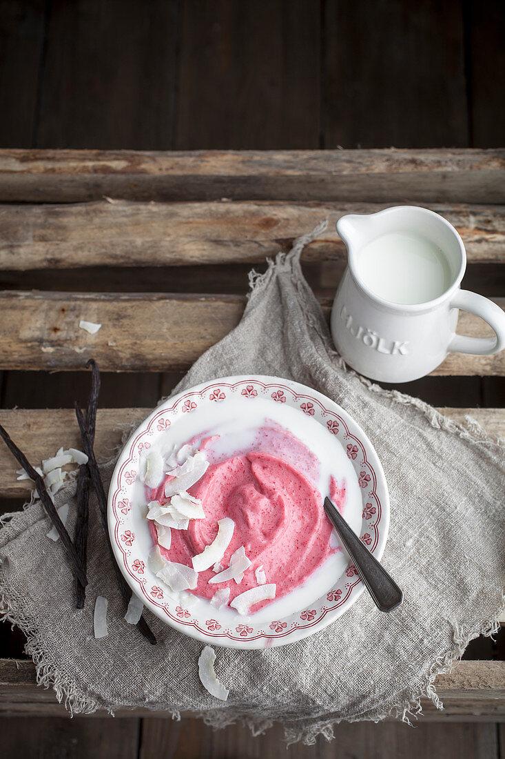 Cranberry porridge with coconut and milk