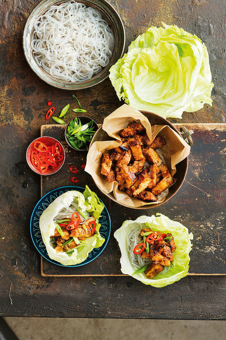 Salad bowls with grilled pork, chili and spring onion