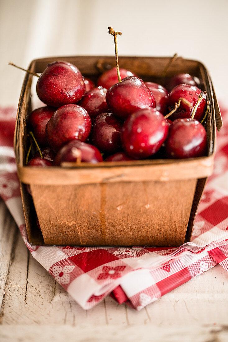 Fresh cherries in a wooden basket