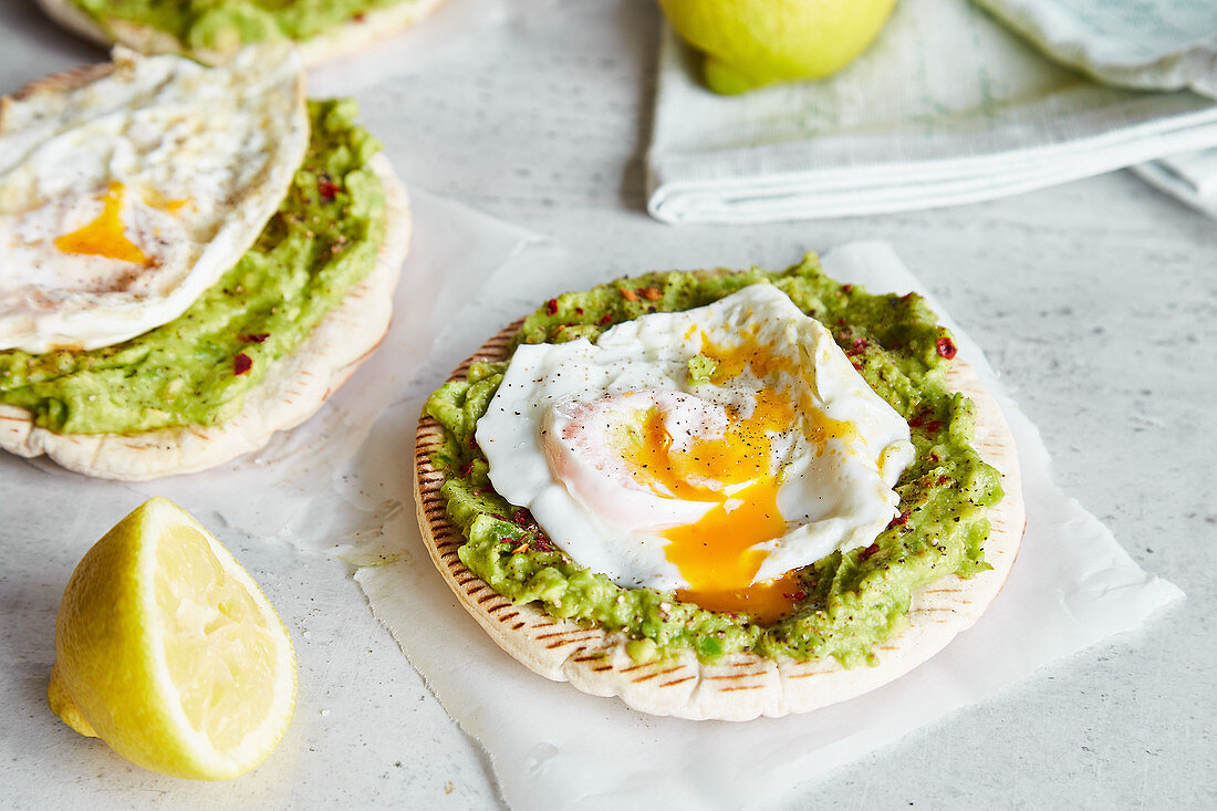 Quick pita pizza with avocado and fried eggs