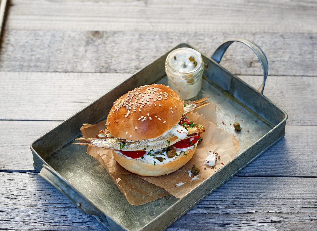 A buger bun with Kieler sprats and a caper dip