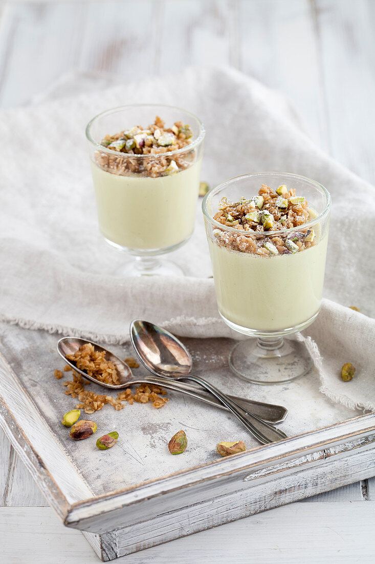 Pistachio panna cotta topped with oatmeal crumble