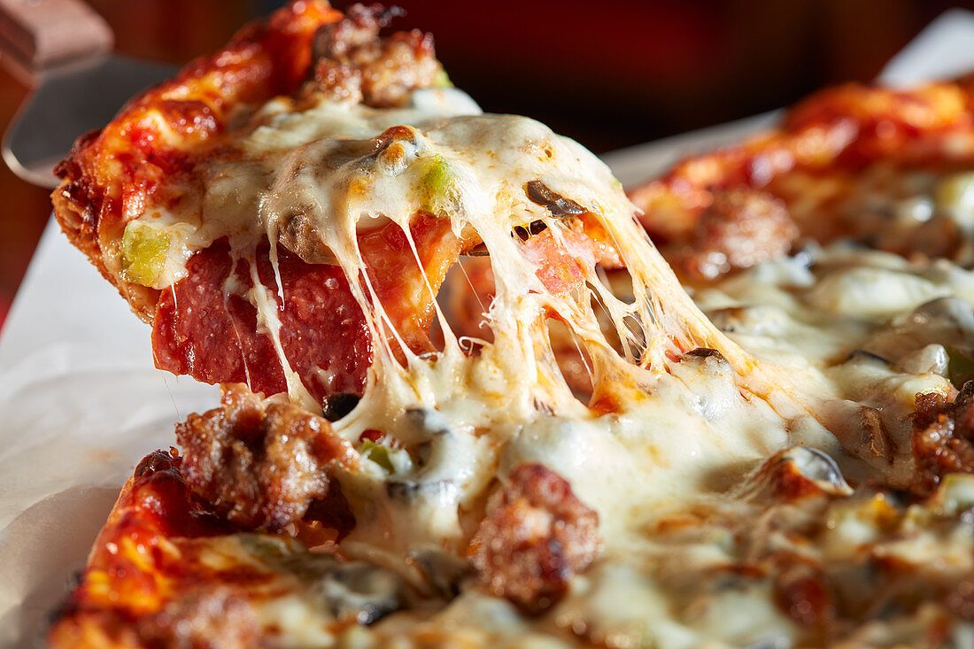 Pizza with sausage and cheese, sliced