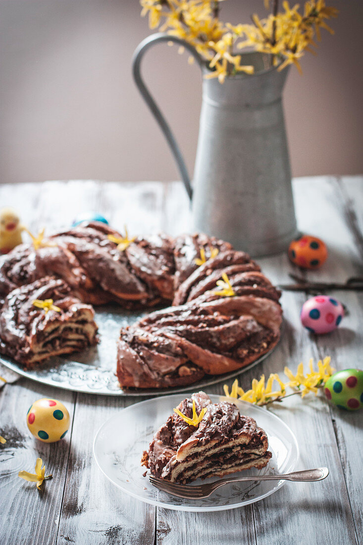 Yeast dough wreath filled with chocolate spread and nuts for Easter