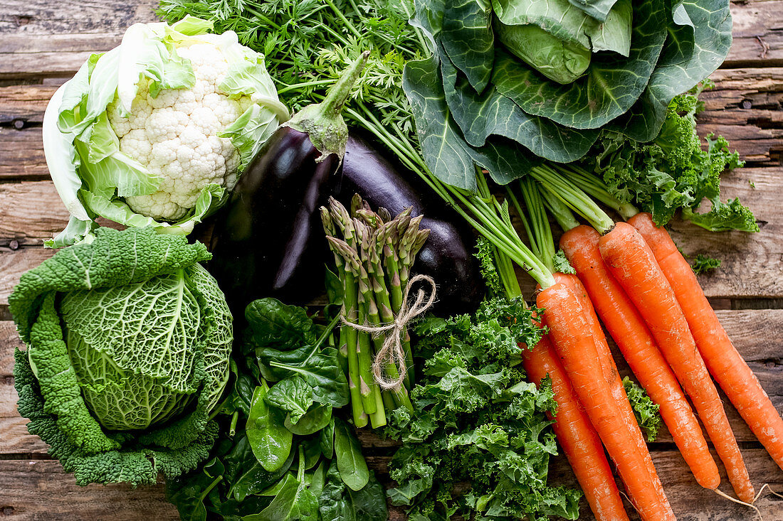 Various vegetables on a wooden background