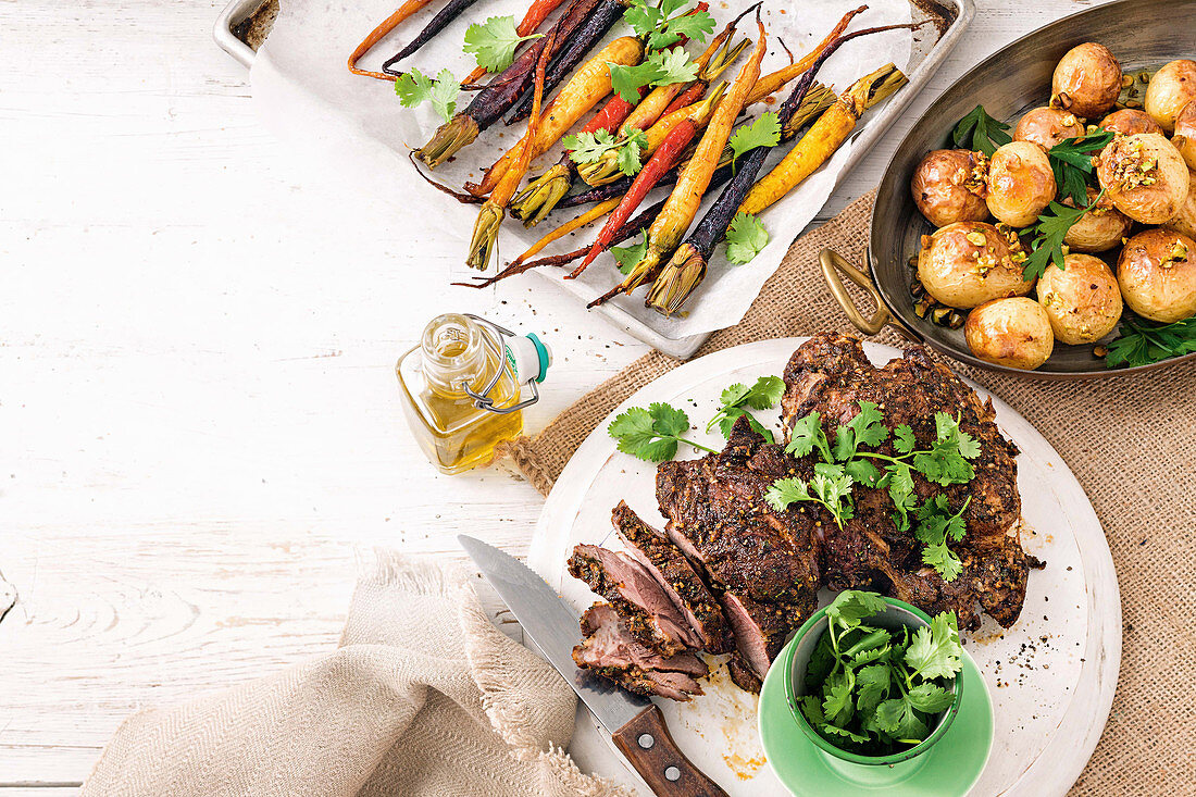 Sticky maple cinnamon roasted carrots; Middle Eastern spiced lamb; Lemon and pistachio roasted potatoes