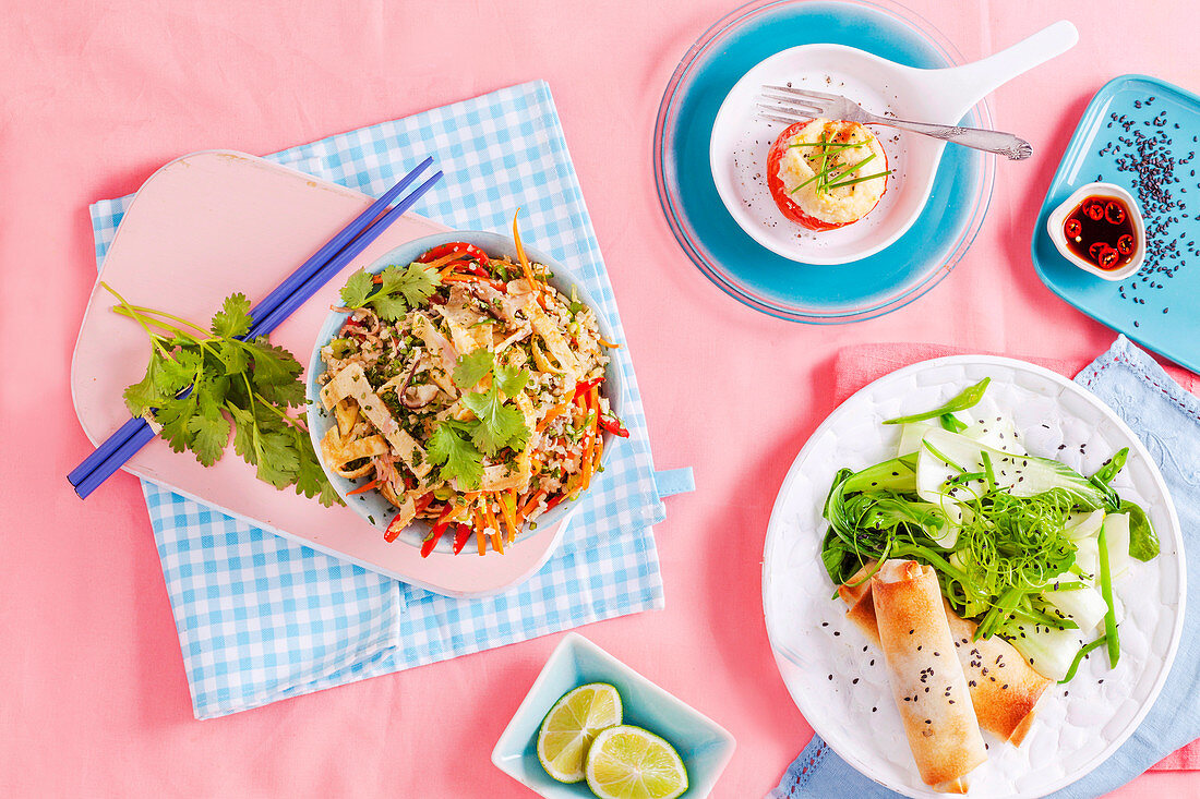 Cauliflower fried rice, oven-baked springrolls and egg baked in a tomato