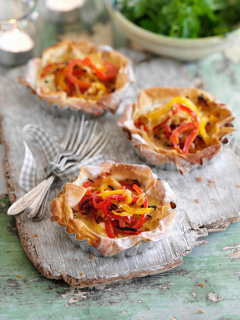 Filo pastry tarts with peperonata and cheese
