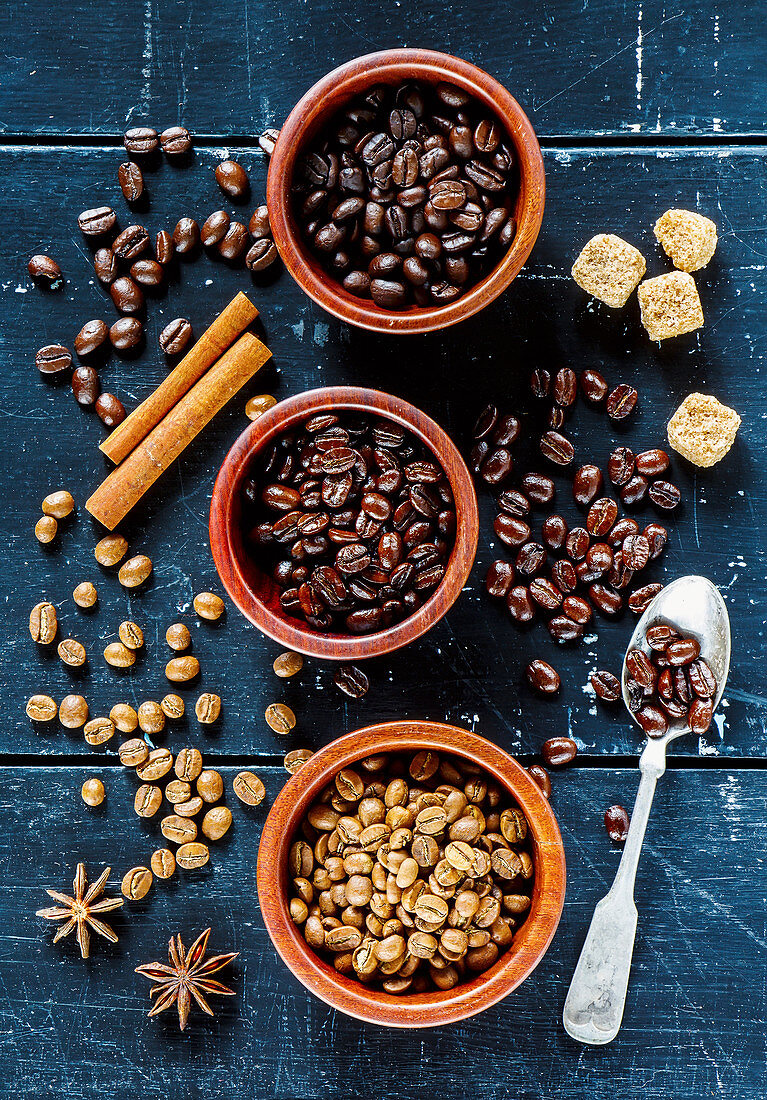 Dark vintage background with different various of coffee beans