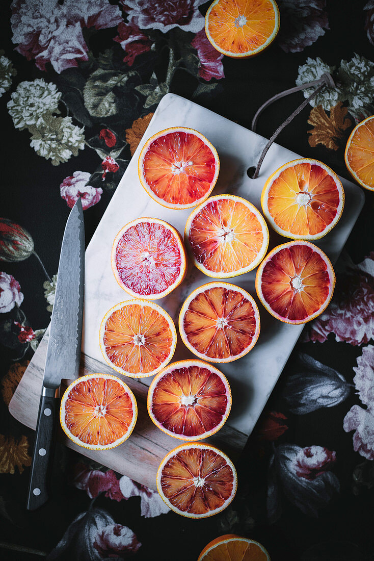 Blood orange halves on a chopping board