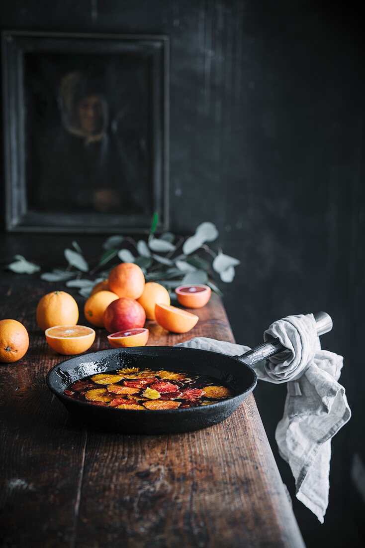 Caramelized blood oranges in an iron pan