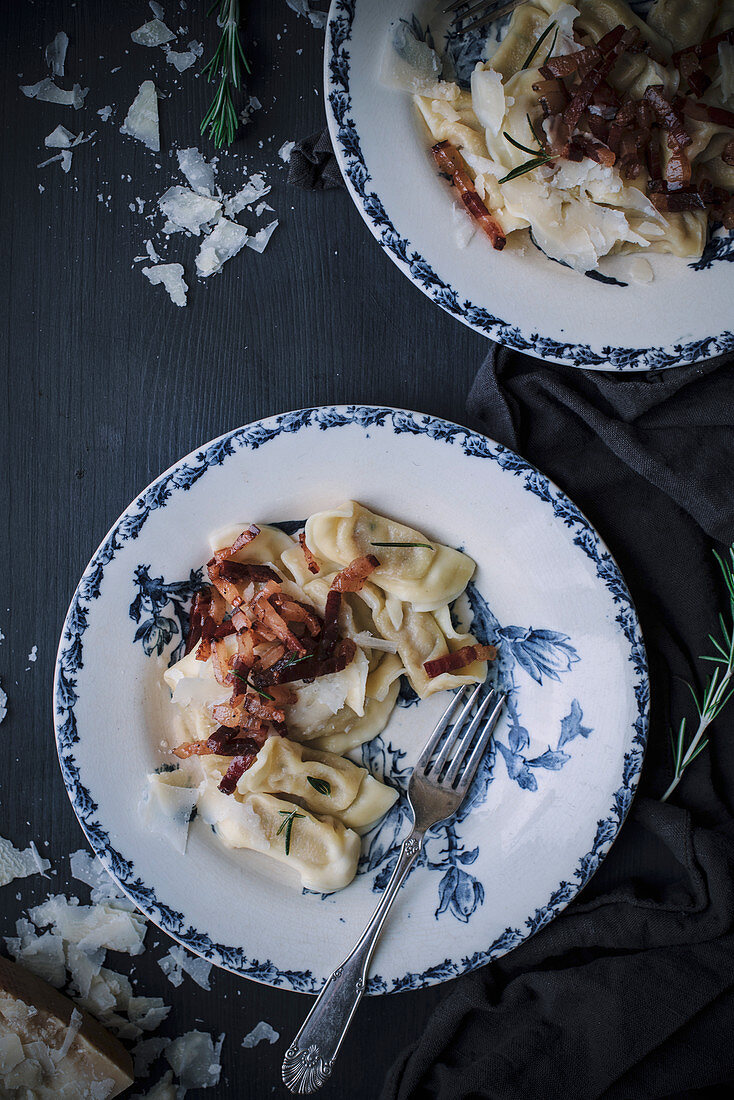 Scarpinocc (filled pasta, Italy) with ham, cheese and rosemary
